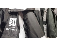 RHSU branded security jackets on a rail.